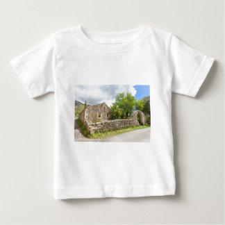 Old historic house as ruins along road baby T-Shirt