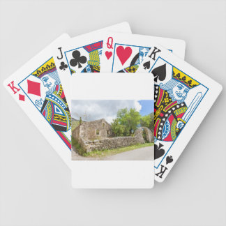 Old historic house as ruins along road bicycle playing cards