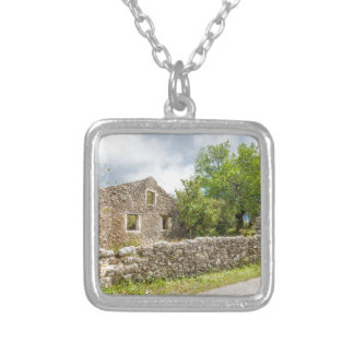 Old historic house as ruins along road silver plated necklace