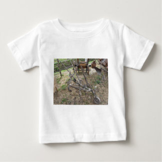Old iron plow and other agricultural tools baby T-Shirt