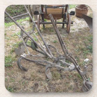 Old iron plow and other agricultural tools coaster