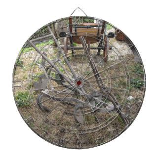 Old iron plow and other agricultural tools dartboard