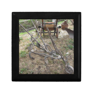 Old iron plow and other agricultural tools gift boxes