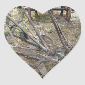 Old iron plow and other agricultural tools heart sticker