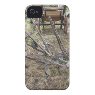 Old iron plow and other agricultural tools iPhone 4 cases