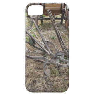 Old iron plow and other agricultural tools iPhone 5 covers