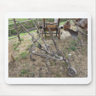 Old iron plow and other agricultural tools mouse pad