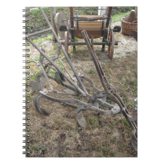 Old iron plow and other agricultural tools notebook