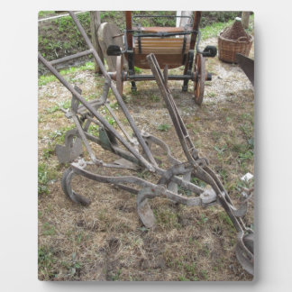 Old iron plow and other agricultural tools plaque