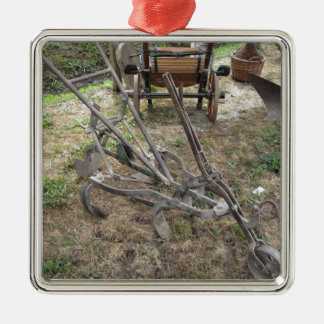 Old iron plow and other agricultural tools Silver-Colored square ornament