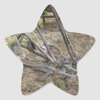 Old iron plow and other agricultural tools star sticker