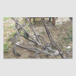 Old iron plow and other agricultural tools sticker