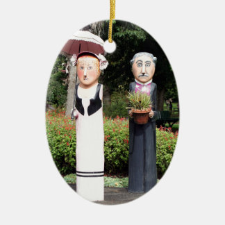 Old married couple sculptures ceramic oval ornament