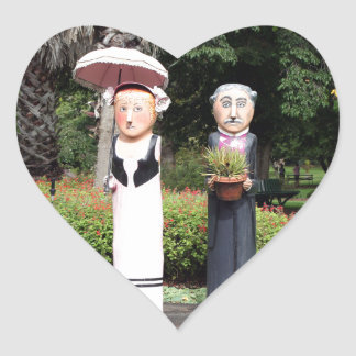 Old married couple sculptures heart sticker