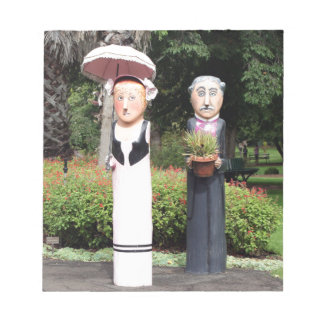 Old married couple sculptures notepad