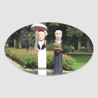 Old married couple sculptures oval sticker