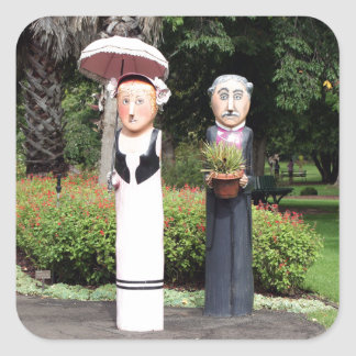 Old married couple sculptures square sticker