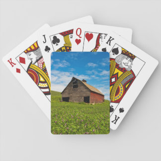 Old, red barn in field of chickpeas poker deck