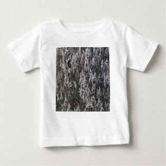 Old reed grass on a winter day. baby T-Shirt
