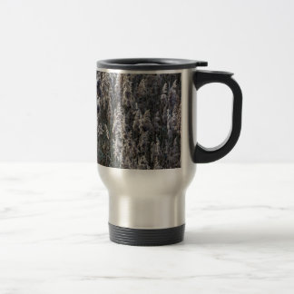 Old reed grass on a winter day. travel mug