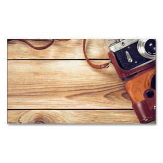 Old Retro Camera On Wooden Table Background Magnetic Business Card