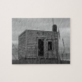 old settlers shack on the hill in black and white jigsaw puzzle