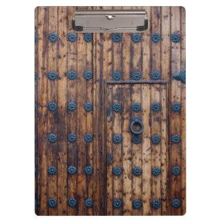 Old Small Door Within Large Reinforced Wooden Door Clipboard