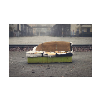 Old sofa in A dirty town center Canvas Print