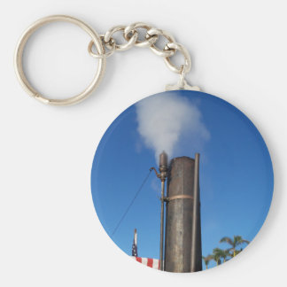 old steam whistle with a white plume of steam keychain