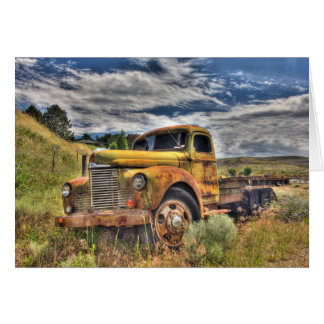 Old truck abandoned in field greeting card