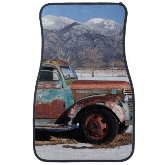 Old truck sitting in the field floor mat