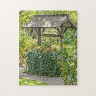 Old well in a garden photo puzzle