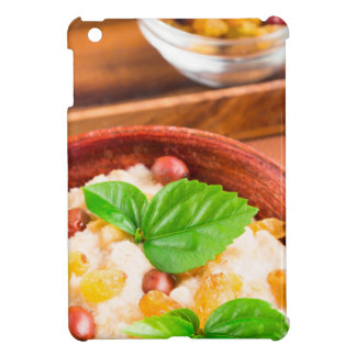 Old wooden bowl of healthy oatmeal with berries iPad mini cover
