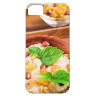 Old wooden bowl of healthy oatmeal with berries iPhone 5 case