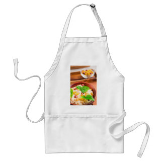 Old wooden bowl of healthy oatmeal with berries standard apron