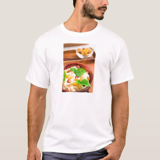 Old wooden bowl of healthy oatmeal with berries T-Shirt