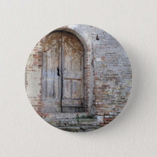 Old wooden door in old brick wall 2 inch round button