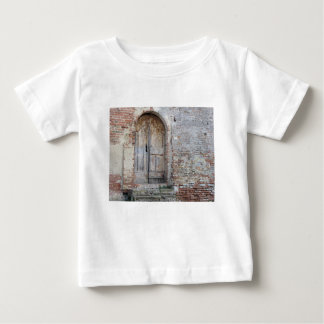 Old wooden door in old brick wall baby T-Shirt