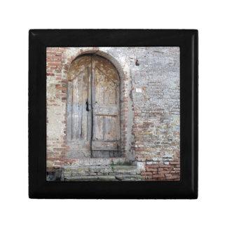 Old wooden door in old brick wall gift box