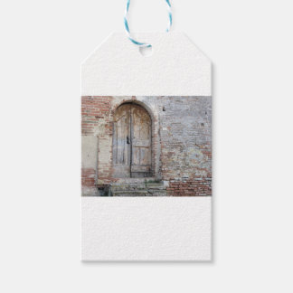 Old wooden door in old brick wall gift tags