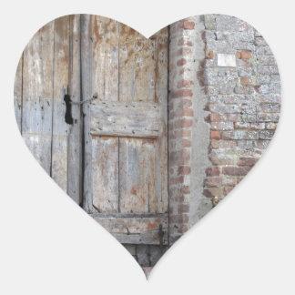 Old wooden door in old brick wall heart sticker