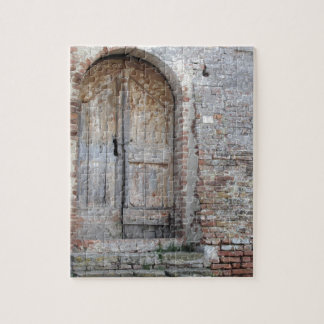 Old wooden door in old brick wall jigsaw puzzle