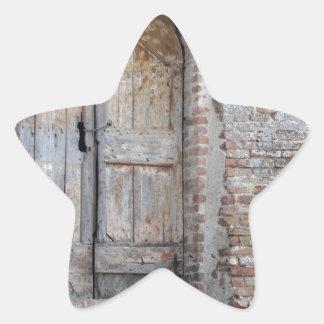 Old wooden door in old brick wall star sticker