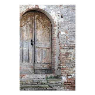 Old wooden door in old brick wall stationery