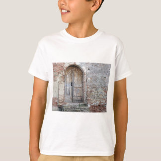 Old wooden door in old brick wall T-Shirt