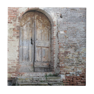 Old wooden door in old brick wall tile