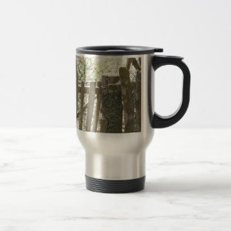 Old wooden gate, covered in ivy and moss travel mug