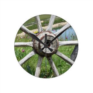 Old wooden wagon wheel round clock