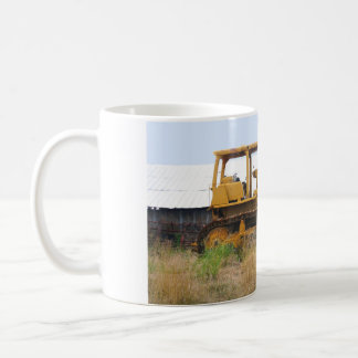 Old Yellow Bulldozer Parked In A Pasture Coffee Mug