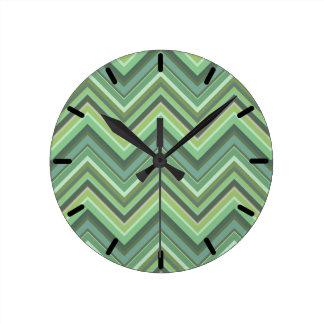 Olive green zigzag stripes round clock